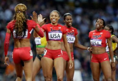 United States' Sanya Richards-Ross, left, celebrates with teammate United States' Allyson Felix, second left, as teammates Francena McCorory, right, and Deedee Trotter during the athletics in the Olympic Stadium at the 2012 Summer Olympics, London, Saturday, Aug. 11, 2012. (AP Photo/Lee Jin-man)